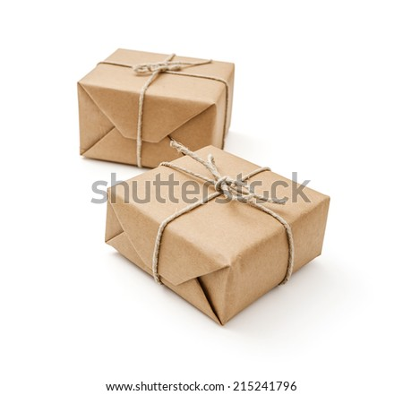 Parcels wrapped with brown paper and tied on white background - stock photo