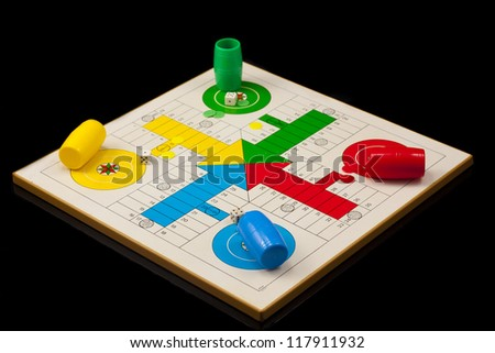 parchis, tipical spanish game, isolated on black