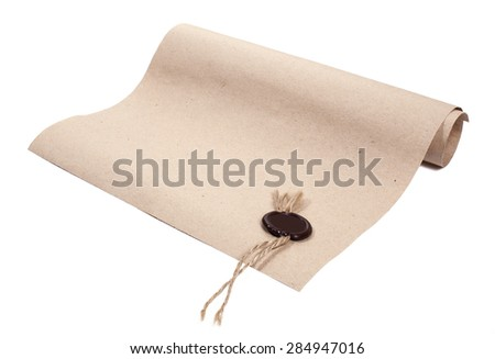 Parchment paper with a wax seal on a white background - stock photo