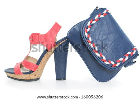 Pare of trendy navy blue and pink shoes, with matching bag,  isolated on white background - stock photo