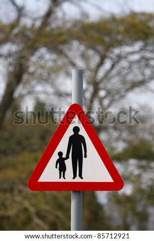 Parent and child road safety sign - stock photo