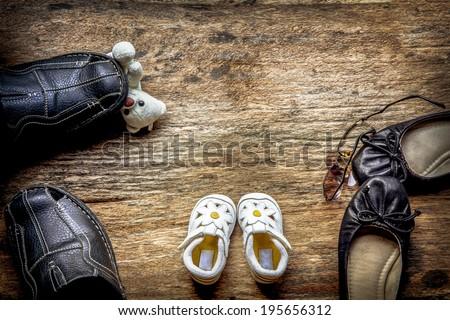 Parent and child shoes - Squabble - stock photo