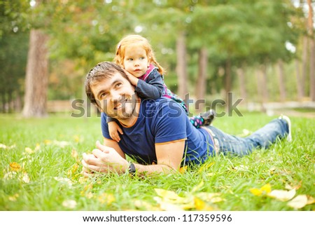 Parent and child - soft focus (focus on eyes of father) - stock photo