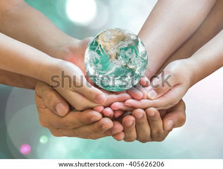 Parent and children together nurture holding green planet globe on person hands on blur nature greenery background sun flare: Environment CSR ESG concept. Elements of this image furnished by NASA - stock photo