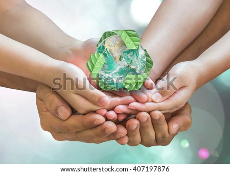 Parent guardian children holding together recycled green leaf sign planet on person hand on blur nature greenery background sun flare Environment CSR ESG concept Element of the image furnished by NASA - stock photo