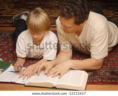 Parent helping child with homework - stock photo