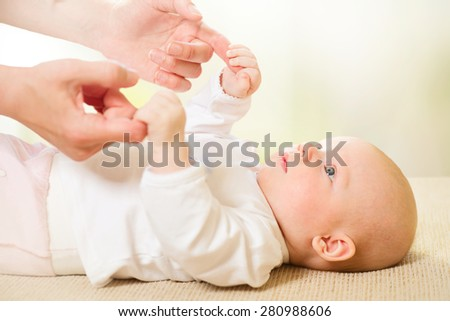 Parent holding newborns hand. Hand in hand. Mother and her Newborn Baby. Happy Mother and Baby together. Maternity concept. Parenthood. Motherhood Motherhood  - stock photo