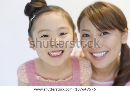 parents and child with big smile - stock photo