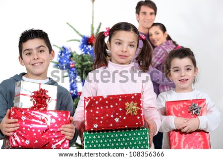 parents and children at Christmas time - stock photo