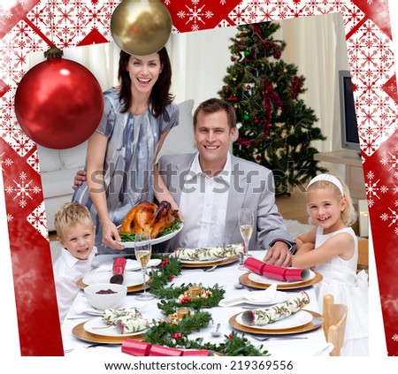 Parents and children celebrating Christmas dinner with turkey against christmas themed page - stock photo