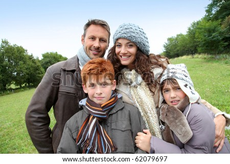 Parents and children having a walk in countryside - stock photo