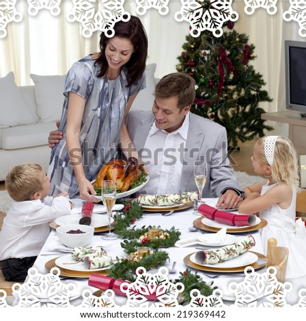 Parents and children in Christmas dinner with turkey against snowflake frame