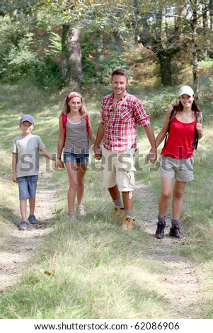Parents and children on a hiking day - stock photo