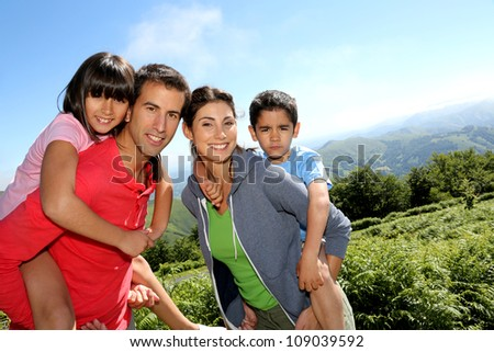 Parents and children standing in natural landscape