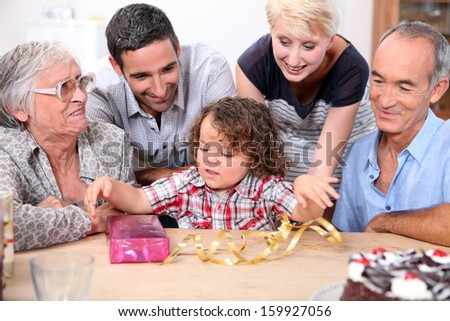 Parents and grandparents with a boy on his birthday