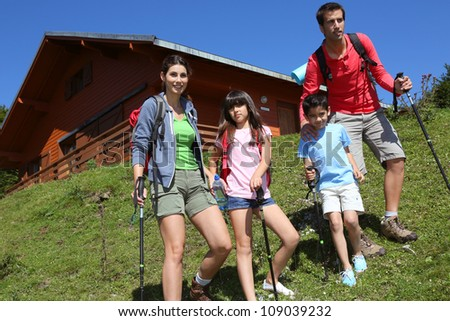 Parents and kids on a trekking day in the mountain