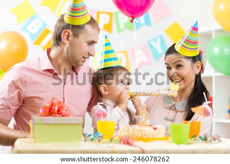 parents and their son celebrating kid's birthday
