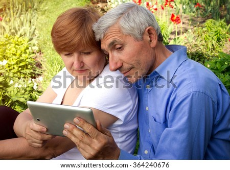 Parents are learning new technologies - stock photo