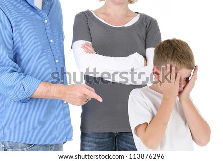 Parents Discipline a Young Boy with Head in Hands - stock photo