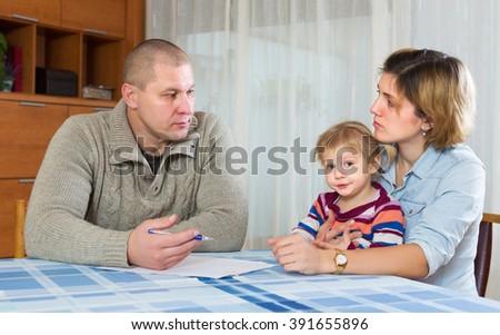 Parents discussing parental guardianship before divorce - stock photo
