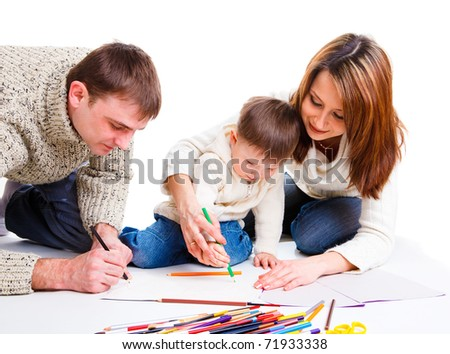 Parents drawing together with  their toddler son - stock photo