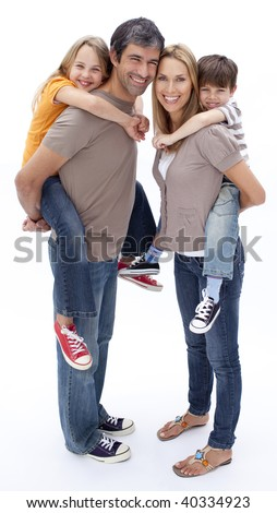 Parents giving children piggy back ride against white background