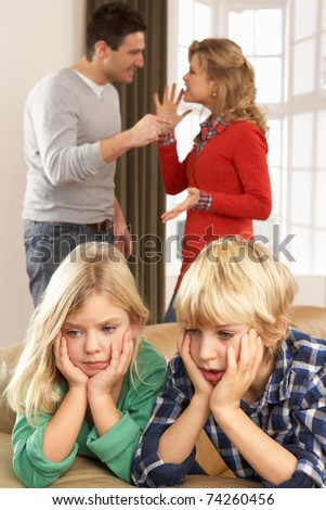 Parents Having Argument At Home In Front Of Children - stock photo