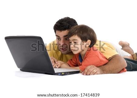 Parents having fun using the Laptop . - stock photo