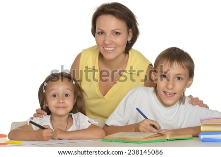 Parents help children do their homework at table