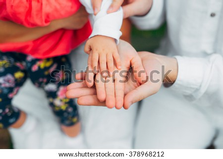 Parents hold child