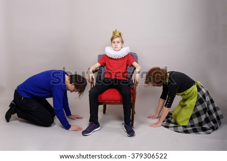 Parents kneel down before their son. Parenting style concept - stock photo