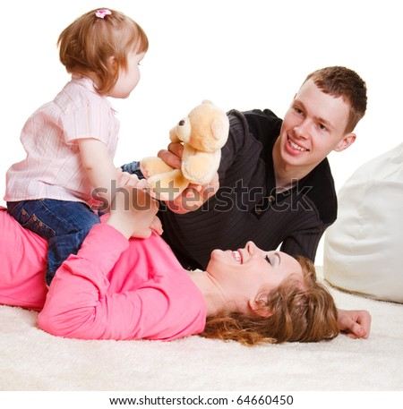 Parents playing with toddler girl - stock photo
