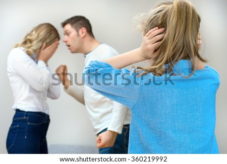 Parents quarreling at home, child in shock. - stock photo
