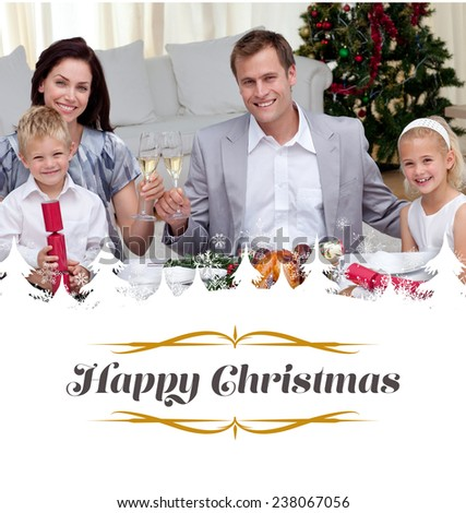 Parents toasting with wine in Christmas dinner against border - stock photo