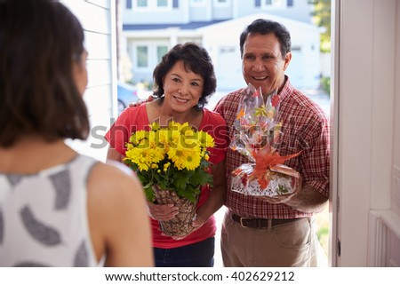Parents Visiting Hispanic Daughter In New Home - stock photo