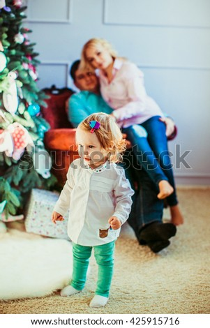 parents watch their little daughter - stock photo