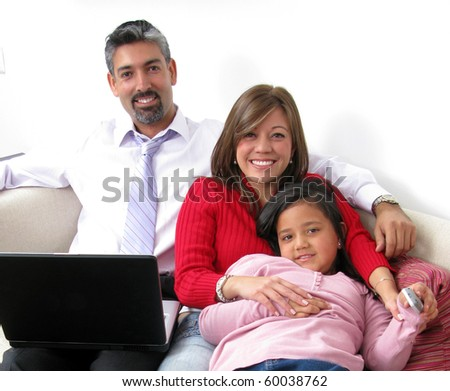 Parents whit son look in notebook and television - stock photo