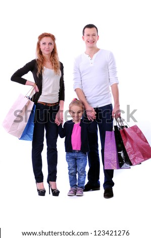 Parents with a child with shopping on white background