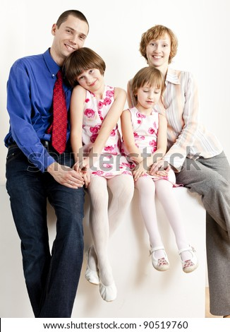 parents with their daughters - stock photo
