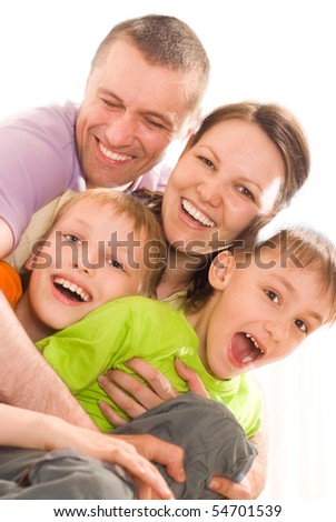 parents with their two children - stock photo