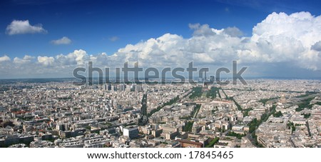 Paris aerial panoramic view from Montparnasse tower over Champs de Mars and Eiffel tower. - stock photo