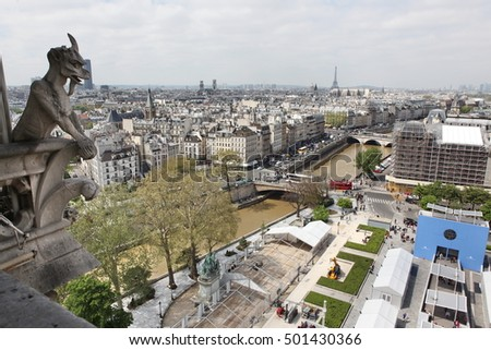 Paris and Notre Dame Cathedral - Paris  famous of all Chimeras, overlooking the skyline of Paris