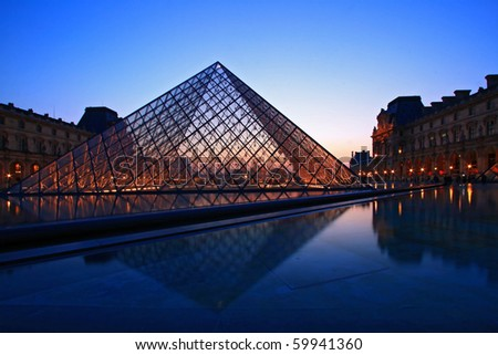 PARIS - APRIL 16: Closeup of Louvre pyramid at Dusk during the Egyptian Antiquities Summer Exhibition April 16, 2010 in Paris. This is one of the most popular tourist destinations in France. - stock photo