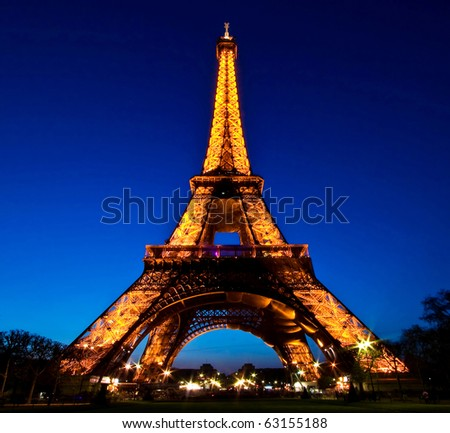 PARIS - APRIL 20: Eiffel Tower Light Beam Show  at dusk, closeup on April 20, 2010 in Paris, France. Eiffel Tower is the highest monument in France use 20,000 light bulbs in the show. - stock photo