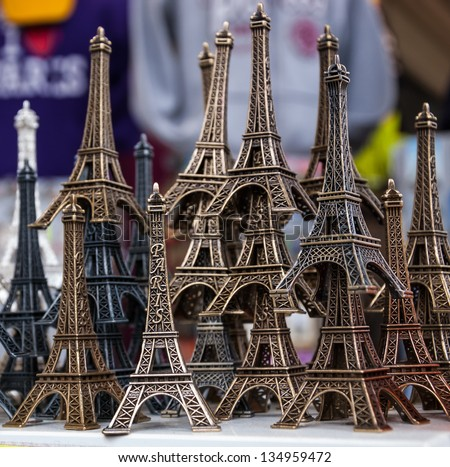 PARIS - APRIL 6:  Eiffel tower statuettes for sale as seen on April 6, 2013 in Paris, France. Eiffel tower statuette is one of the most popular souvenirs to bring from Paris.