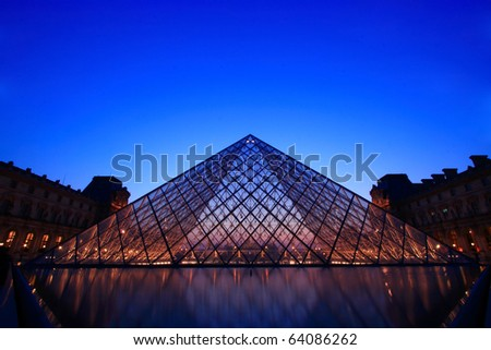 PARIS-APRIL 16: Silhouette of Louvre pyramid at Evening during the Summer Antiquities Exhibition on April 16, 2010 in Paris, France.The Louvre is the biggest Museum in Paris displayed over 60,000 Sq.m. of exhibition space. - stock photo
