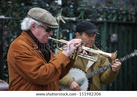 PARIS - APRIL 27: Unidentified musician play before public outdoors on April 27, 2013 in Paris, France. Everyday more 100 buskers perform on the streets and in the metro of Paris - stock photo
