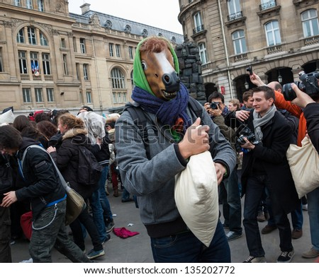 PARIS - APRIL 6: Unidentified participant of pillow fight in funny horse mask as seen on April 6, 2013 in Paris, France. This year the International Pillow Fight Day was celebrated  on April 6.