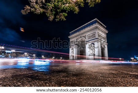 Paris arc de triomphe (arch of Triumph), night city lights - stock photo