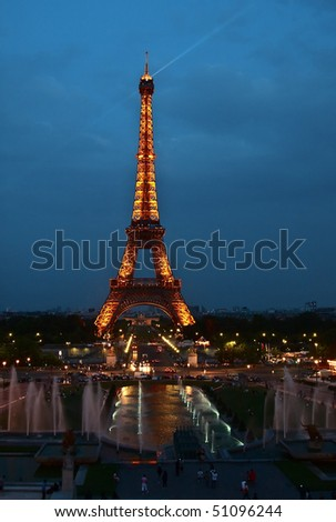 PARIS - AUGUST 15: Eiffel Tower at night August 15, 2010 in Paris, France. The Eiffel tower is the most visited monument of France and the most recognizable landmark of the world